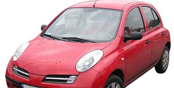 And older model of the Nissan Micra in red