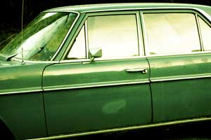 Old green car ready for disposal