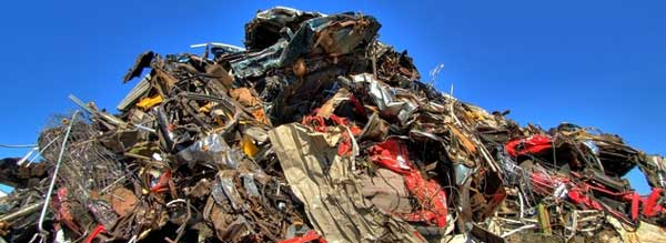 pile of crushed metals from old vehicles